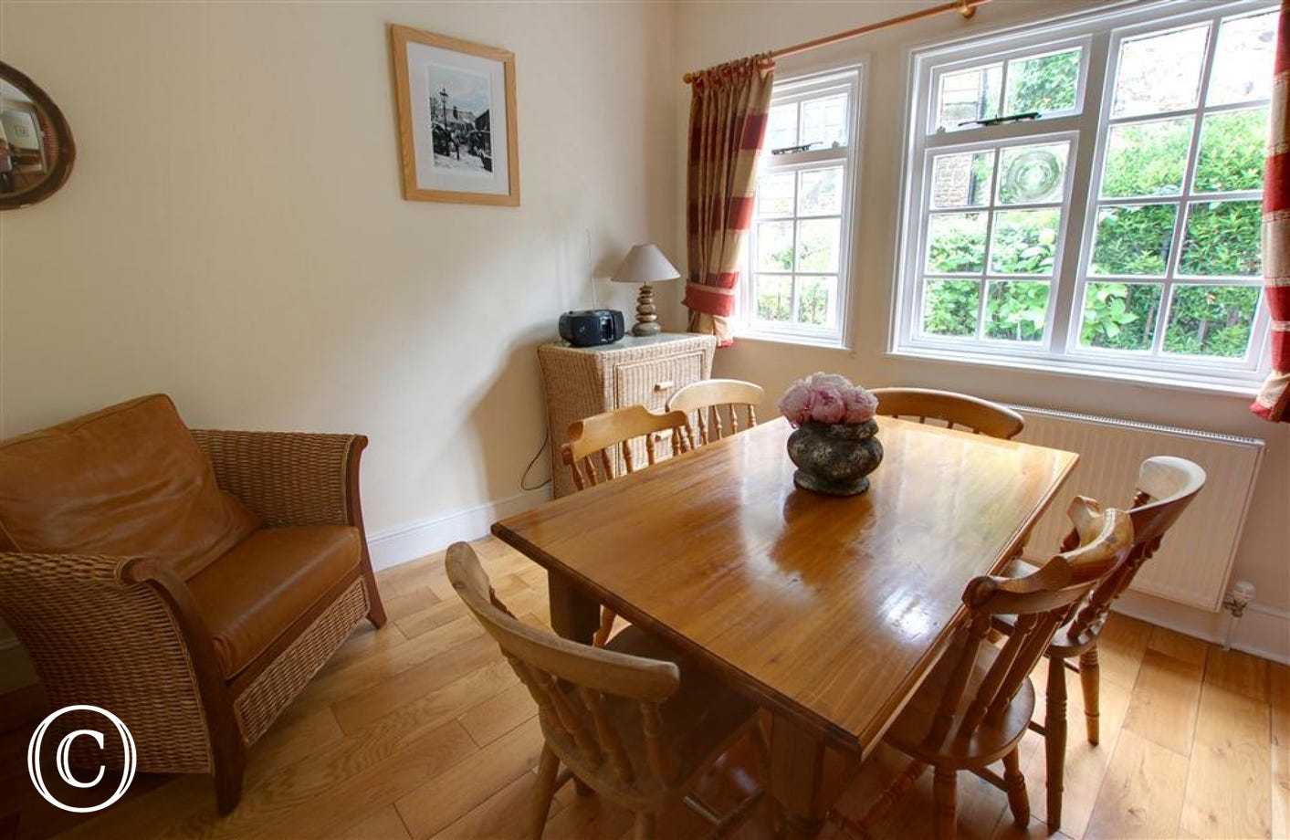 Step down into this lovely dining room with views out to the lane