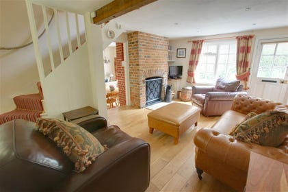 Warm, welcoming and child friendly cottage with very comfortable sitting room - with a real open fire