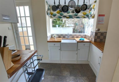 Quirky and clever - the kitchen has been carefully designed to work well but keep the character of the cottage