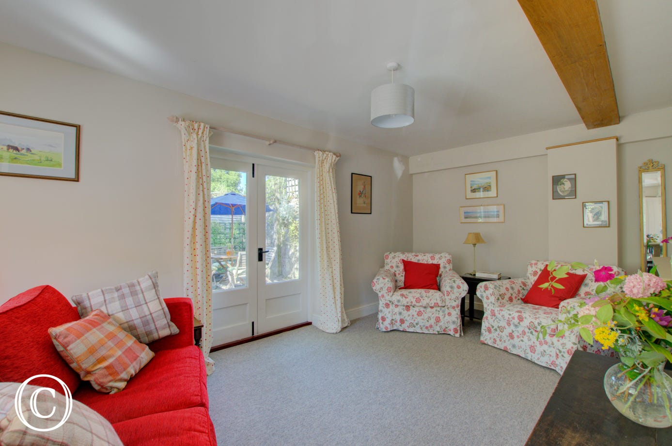 Bright living room with French doors to rear garden