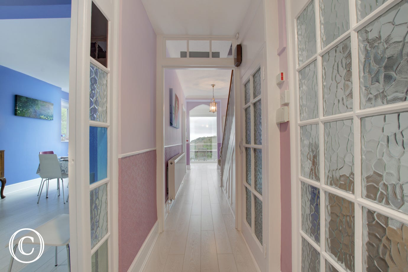 Light hallway with views towards Lyme Bay