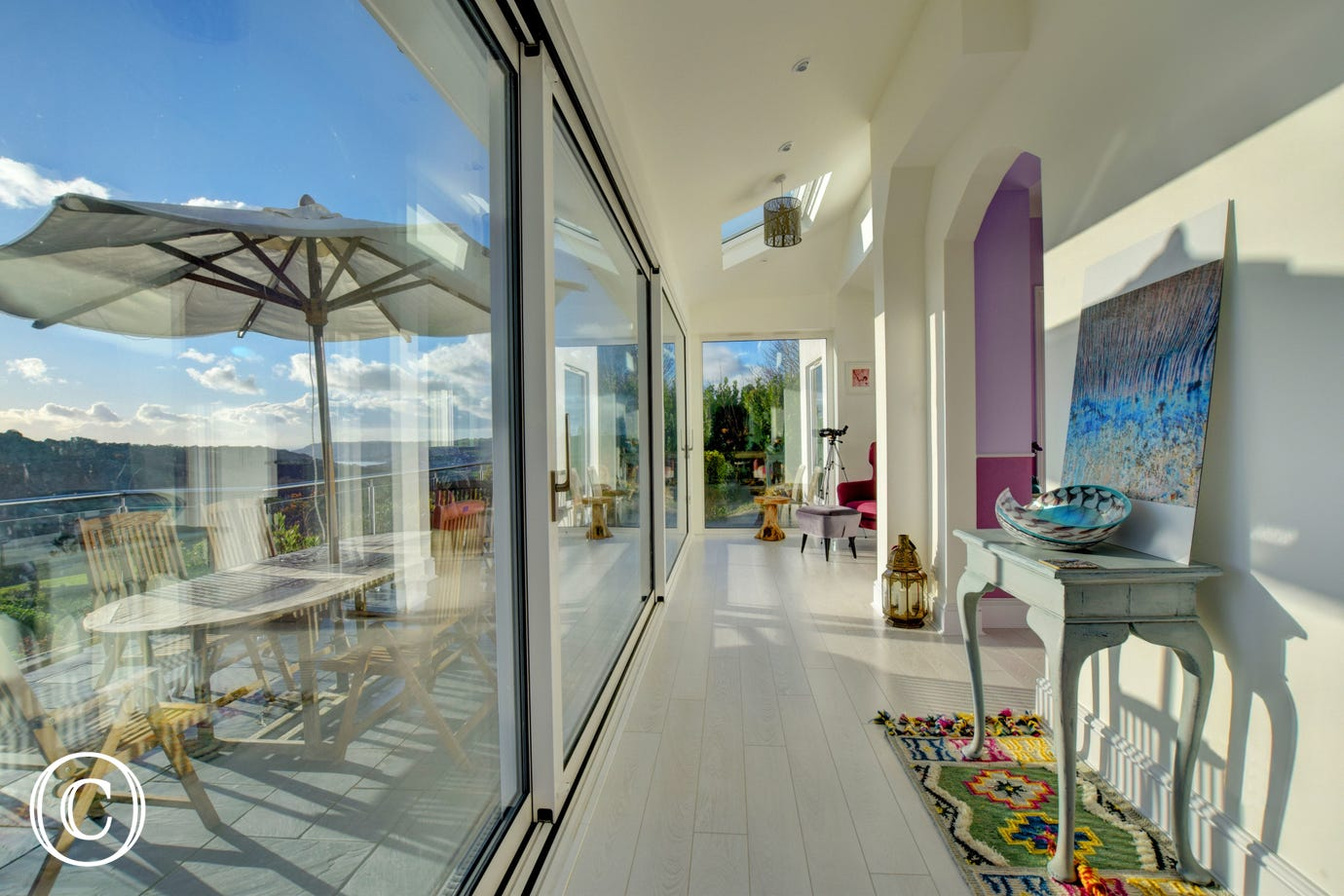 Glass fronted, south facing sun room with stunning views across Lyme Bay