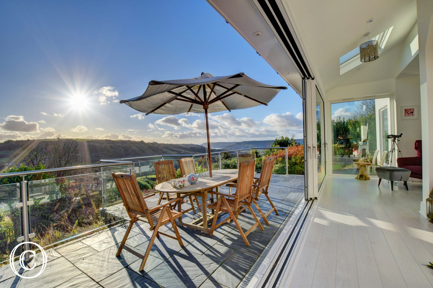 Sun terrace with seating and panoramic views across Lyme Bay