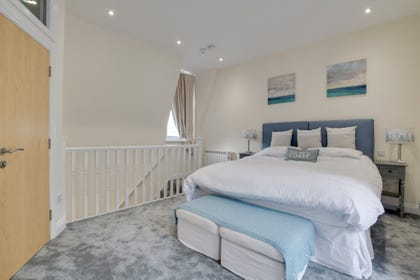 Master bedroom with Juliette balcony and ensuite bathroom