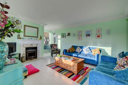 Triple aspect living room with real fire and fantastic views across Lyme Bay