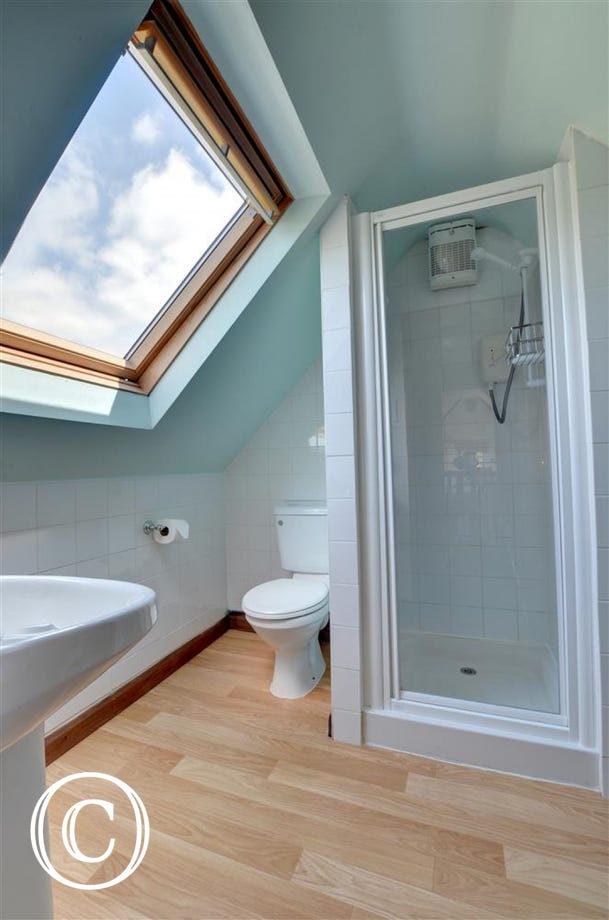 Lovely bright spacious shower room with velux window