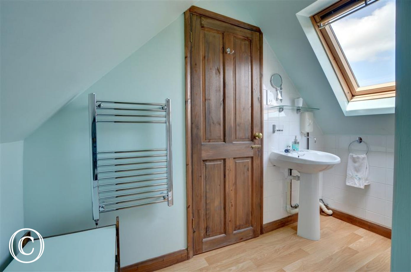 Shower room showing towel rail and hand basin