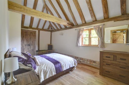 Lovely double bedroom with tasteful furnishings.