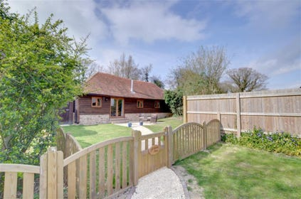Privately gated cottage with garden.