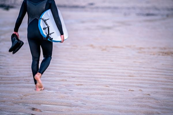 Walking with a surf board