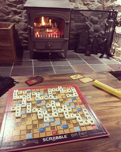 A lit log burner and a game of Scrabble in the evening