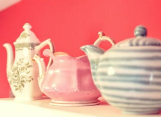 A row of collectible teapots