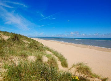 The fine pale sands and dunes of Norfolk's coastline are worth visiting