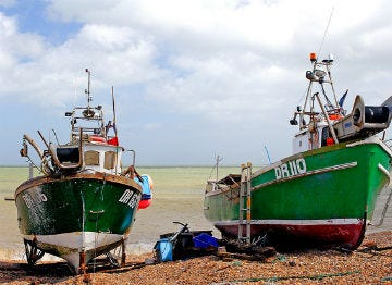 Boats moored up at Deal on the beach