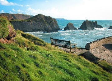 A bench looking over the sea at Hartland in North Devon