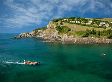 A speed boat of the clear sea waters at Combe Martin