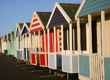 The iconic beach huts of Southwold Beach, now available to hire!