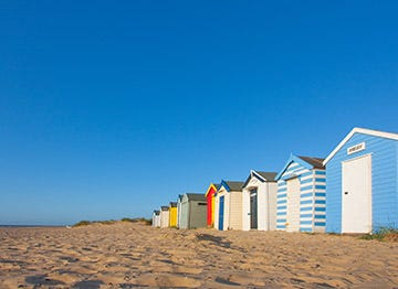 The iconic and colourful beach huts of Suffolk