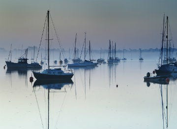 Sailing boats on the tranquil water