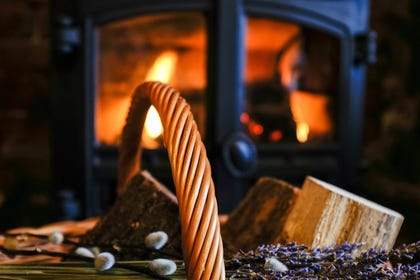 Enjoy the warmth of the fire in your Christmas cottage