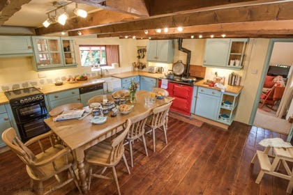 spacious dining kitchen with cherry red aga