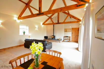 Huge living area with underfloor heating and log burner